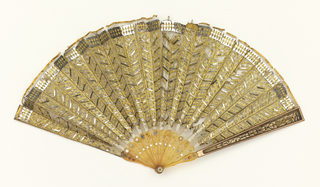 Pleated fan with a fine silk net leaf appliquéd with gold-colored metal foil and sequins in chevron pattern; reverse: plain. Celluloid sticks inlaid with sequins. Celluloid guards with copper and inlaid with gold-colored metal foil.