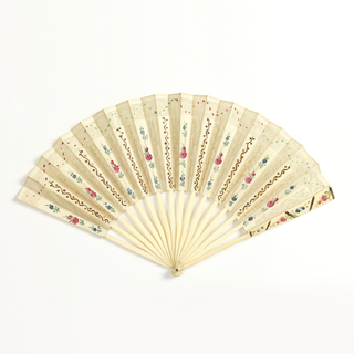 Pleated fan. Paper leaf pierced to give the effect of lace. Obverse painted with flowers in blue, green and red. Alternate folds have design of wavy line and dots. Bone sticks. Guards painted with flowers in red, blue, and green.