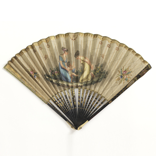 Pleated fan. Gilded paper leaf with hand-colored engraving showing a scene with two women and an infant learning to walk. Sticks are painted wood with ivory on guards.