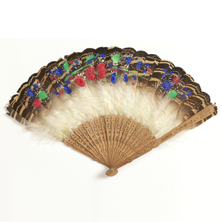 Brisé fan with carved sandalwood sticks, topped with feathers hand-painted with floral designs in blue, green and red tempera.