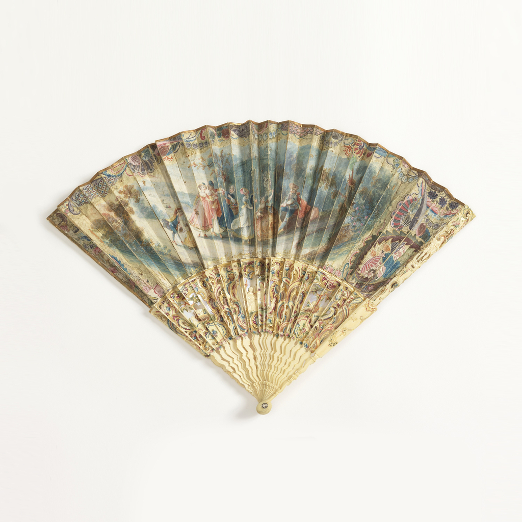 Pleated fan. Parchment and silk leaf, gilded and painted with gouache. Obverse: scene of playing maidens against a ruin, in the style of Louis XVI. Rococo border of shells, latticework, foliage, fantastic forms and scenes. Reverse: plain silk. Sticks and guards careved, painted and filled with mother-of-pearl. Feather design and scenes.