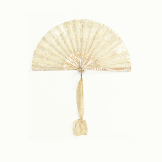 Folding fan with a leaf of white bobbin lace with swirling floral patterns. Sticks of plain mother-of-pearl, with a wide white silk ribbon.