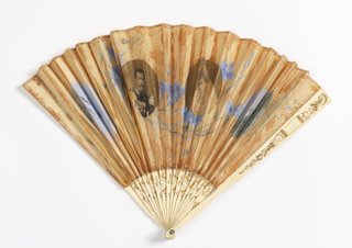 Pleated fan. Silk leaf painted with watercolor commemorating the visit to Paris of Czar Nicholas II and the Czarina in 1896. The rest of the leaf painted with sprays of cornflowers. Pierced, carved and gilded ivory sticks. Paste jewel at rivet.