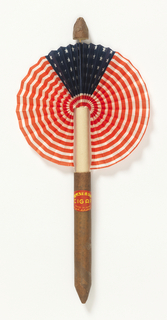 Cocade fan. Leaf of printed and folded paper showing the United States flag. Brown paper handle resembling a cigar