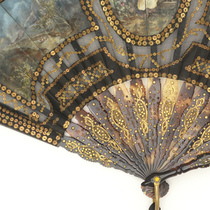 Pleated fan. Leaf of stiffened black net embroidered with spangles in various shapes and appliquéd with painted silk panels; at center, a woman at a fountain; at left, a stormy landscape with castle; at right, a stormy landscape with architecture by waterside. Carved and pierced tortoise shell sticks with gold foil and inlaid piqués. Gilt metal bail and faceted stone at rivet