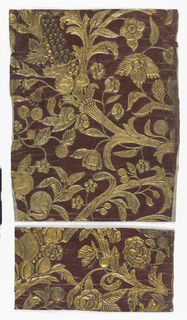 All-over pattern of vine set with flowers and fruit, gold against red ground.