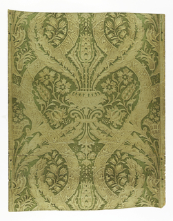 Imitation leather. Large scale design of interlacing bands and conventionalized flowers, with vase and tulip forming center axis. Embossed and gilt, and the ground over-printed with green. Straight match and repeat.