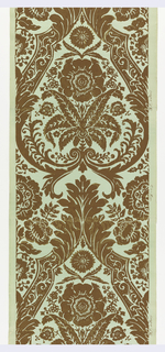 Large-scale floral motif suggesting brocade textile, set within elaborate framework. Printed in brown on green ground.