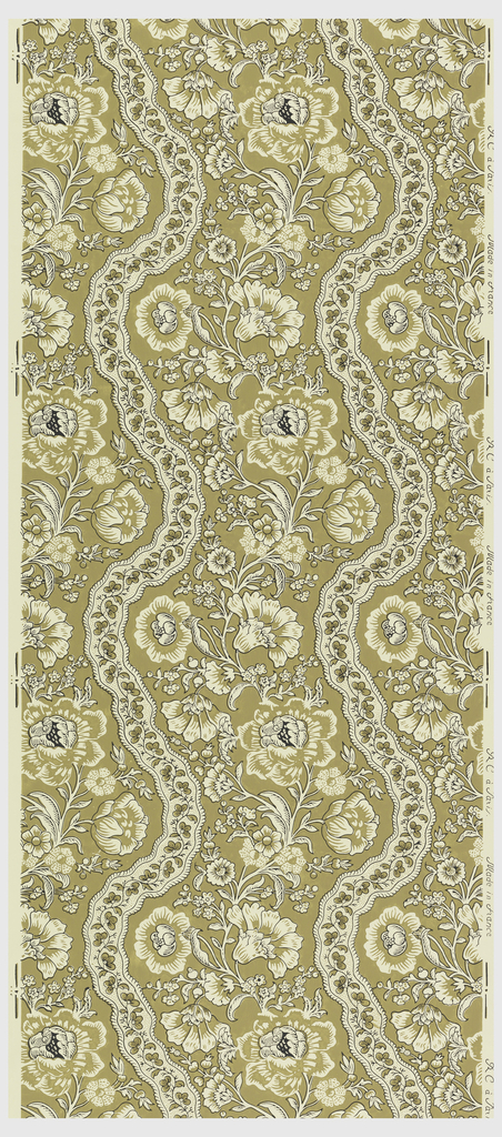 Floral stripe design. Wide bands of wavy vining flowers alternating with narrow bands of waby ribbons. Printed in brown and black on white ground.