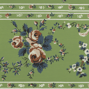 Wide central band with red roses, alternating with smaller white blossoms on stem with white ribbon attached. Above and below are narrow bands containing small-scale floral motifs. Printed in colors on green ground. Printed two across.