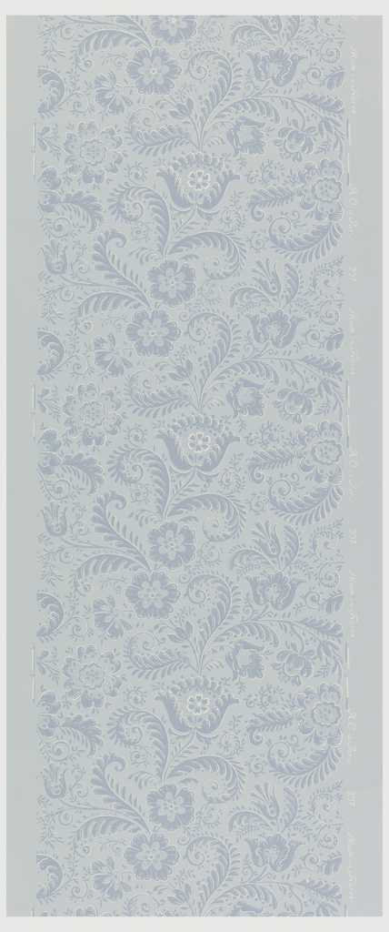 All-over pattern of stylized floral and fern-like tendrils. Printed in medium blue and white on light blue ground.