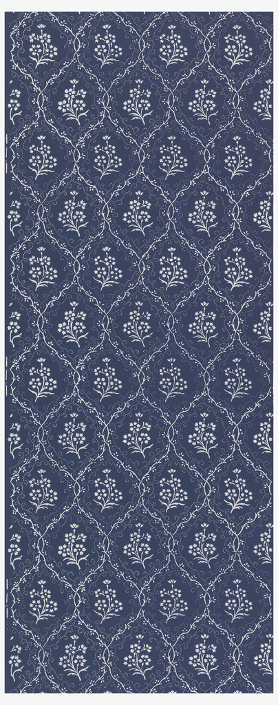 Floral sprigs set within diaper pattern, printed in white on deep blue background.