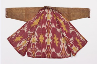 Robe of gold metallic cloth with foundation fabric of terra-cotta silk. Edges trimmed with knitted silk in red, blue, yellow, black and white. Lined with silk and cotton ikat fabric in red, white and yellow.