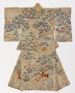 "White ""grass cloth"" kimono, printed in blue and brown ink and embroidered in colored silks and  metallic yarns with pine trees, bamboo, plum blossoms, clouds, a stream crossed by a bridge, birds, etc. Lined in silk."
