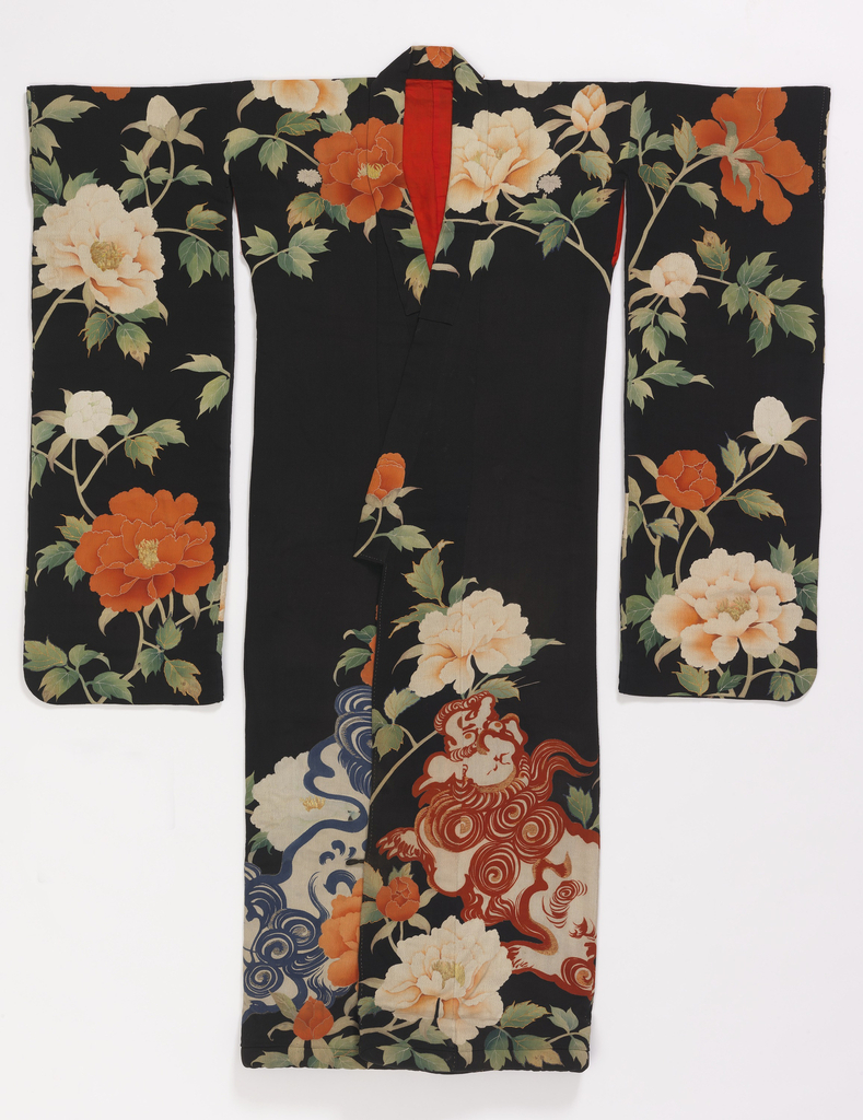 Kimono of black silk crepe with elaborate decoration across shoulers, down the hanging sleeves, and around the bottom. Stencilled and painted flowers, fruit, and two angry dragons. Details of design in couched and embroidered gold thread. Lined with bright red silk.