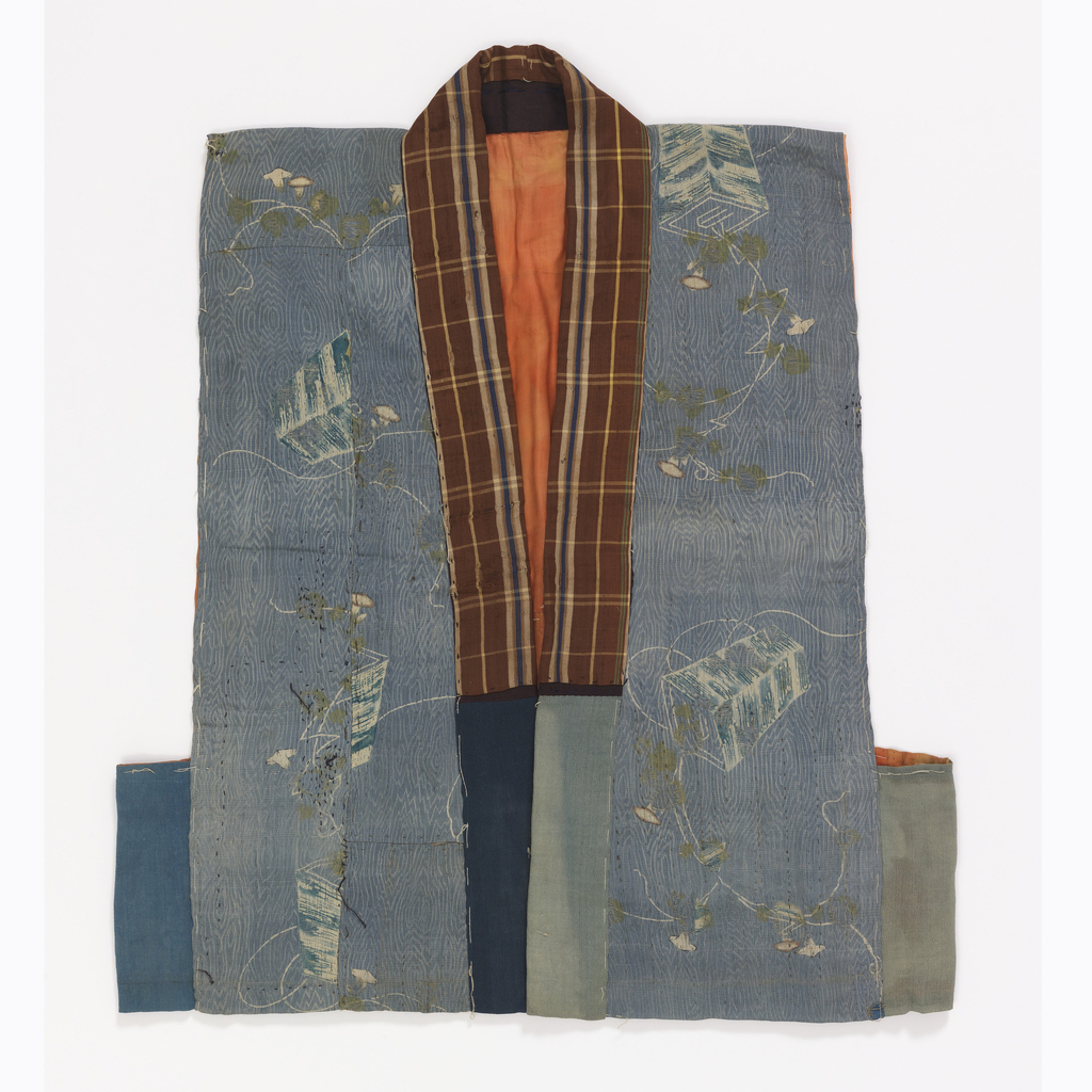Woven silk vest with stencil-applied resist pattern of lanterns and flowering vines in indigo. Ground covered in delicate white lines, suggesting wood vein or mokume. Collar with brown, cream and navy plaid. Blue and green panels at sides. Lined with bright pink silk (much pieced); interlined. Basting stitches suggest repair or remaking.