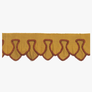 Woven yellow cotton valance with a double layer of lambrequins. Cream and rust colored passimentre trim.