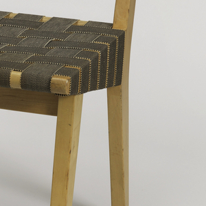 Wood frame consisting of square seat and back on four tapering legs; frame covered in brown cotton webbing.