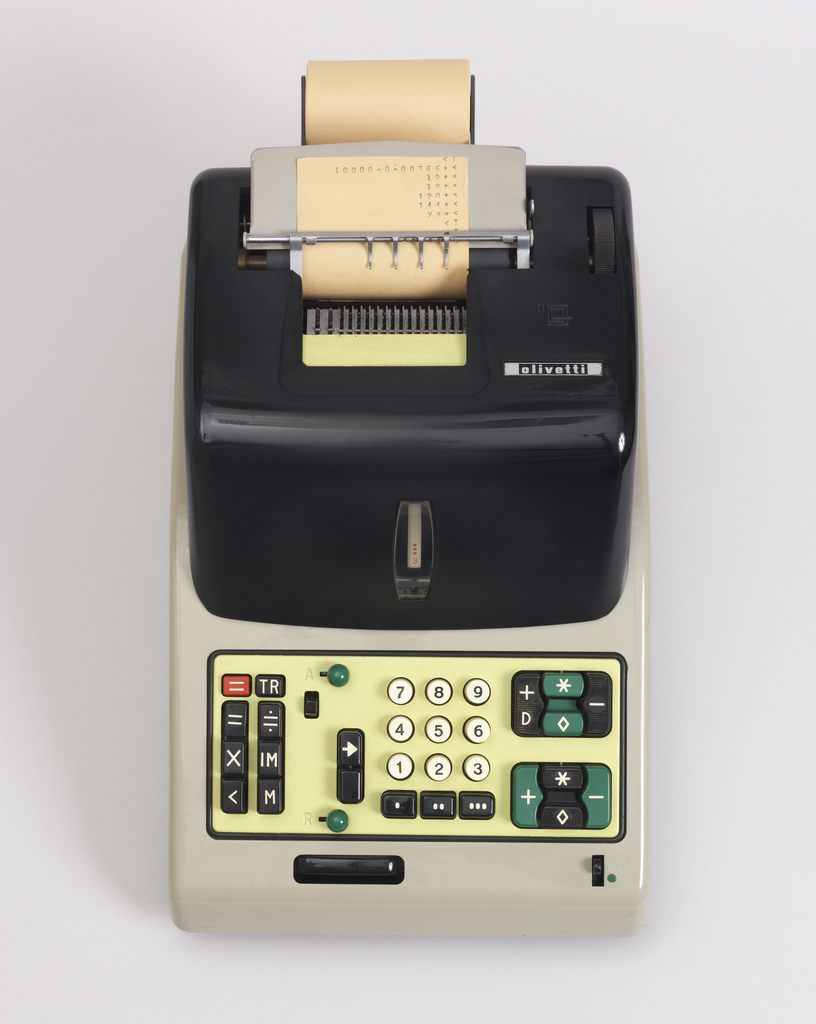 Rectangular gray body with black cover; yellow rectangular keypad section at front, with rows of black, green and red function keys flanking three rows of circular white number keys; cover with opening for paper tape to be dispensed, and paper roll holder at back.