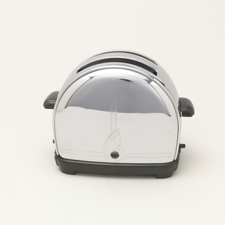 Semi-circle metal toaster with a black base and handles on opposite sides. Two parallel openings on the top for toast.