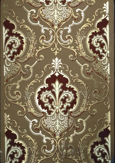 Foliate medallion design. Medallion surrounded by layers of scrolling foliage. Printed in metallic gold, burgundy on tan ground.
