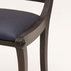The chair back with reeded posts; panelled top rail and reeded lower rail, enclosing the figure of a harp; out-curved front legs, lower half carved to depict fur-covered animals legs and paw feet; trapezoidal, dark blue slip seat in readed frame.