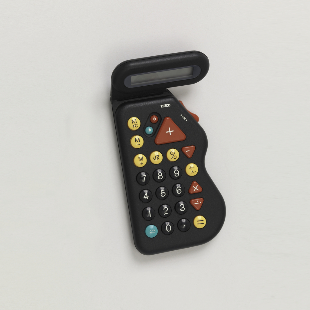 A black plastic rectangle calculator an undulating right side. Buttons are black, yellow, red, and blue.