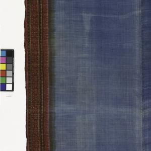 Very large silk piece with blue field surrounded by wide striped and ikat-dyed border in various shapes of red, brown, and white with a little blue. Wefts elaborately ikat-dyed to make pattern. Warps died red at either end and solidly blue for middle section. Garment made of two widths sewn together.