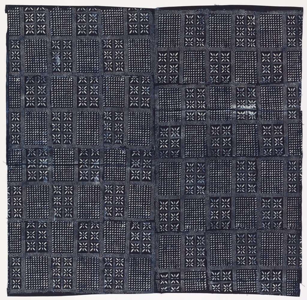 Wrapper with a checkerboard of rectangles separated by rows of dots. Each rectangle is filled alternately with a floral pattern or rows of small triangles. Design reserved in white on an indigo-dyed ground.