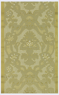 Large-scale diaper pattern with lacy effect. Stylized floral motif set within framework. Printed in white on gold ground.