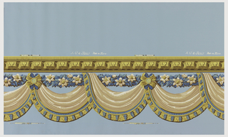 Drapery swags suspended from a floral rod. A fringe hangs from the lower edge of the drapery. An architectural molding is above the rod. Printed in mauve, blue and ocher on a blue ground.