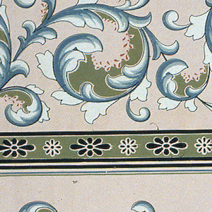 Acanthus rinceau with band of floral motif along bottom. Two borders printed across the width.