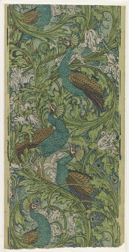 Arabesque of large acanthus rinceaux, tulips, and wiry scrolls, with large perching peacocks whose tails hang downward.