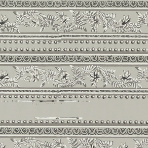 """Band of stylized floral and foliatte """"c"""" scrolls, with narrow band of floral rosettes above, with a band a strung beads both above and below. Printed in grisaille on gray ground.  Printed four across."""