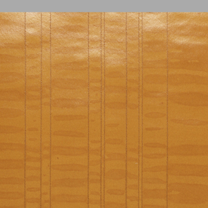 Vertical rows of orange stitching applied to a mottled orange ground. The spacing between stiched rows varies across the width.