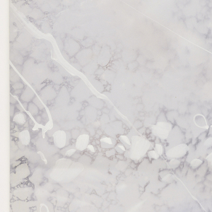 Three similar rolls of imitation or faux marble design, cream colored. The top layer of veining is handpainted over a block printed background pattern.