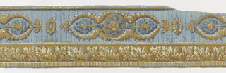 Against a striped background pattern, wide band of this two-band border design contains an oval escutcheon alternating with a cartouche which is formed by scalloped acanthus-leaf frame. Cartouche contains stemmed acorns flanking a rosette. The narrow band consists of classically-inspired acanthus cups enclosing half-hidden egg shapes. Bottom edge is dentilled.  H# 541