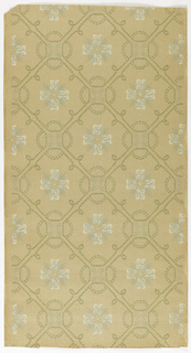 Grid or trellis pattern formed with double rows of dashed lines, has the appearance of a sewn stitch. Cloverleaf design at intersections and stylized floral  motif in center of each void. Printed on ungrounded paper with pattern of dashed lines, almost like fingerprints.
