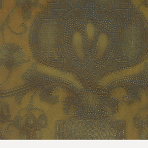 Central medallion and urn motif, from which sprouts stylized foliage and fruit clusters. In style of embossed leather. Printed in shades of yellow ocher and tan.