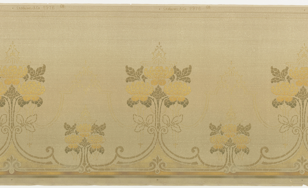 A repeating abstracted floral candelabra design crowned by a linear gold pagoda connected on the bottom to a similar smaller candelabra and on the top by a larger gold pagoda on a striated background above a border of horizontal stripes interruped by repeating fleru-di-lis. Printed in olive green, gold and bronze.