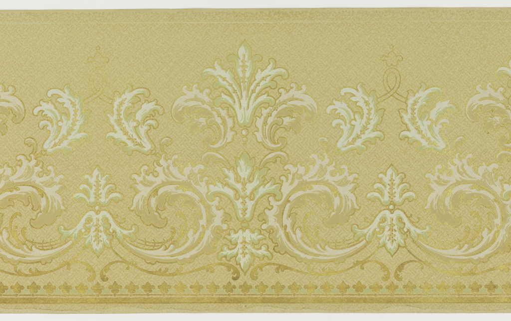 Design entirely rinceau, some in a fleur-de-lis shape. Bottom edge border of silhouettes of fleur-de-lis. On a pale yellow field with vague indication of a woven pattern. Printed in gilt, white, pale green and pale yellow.