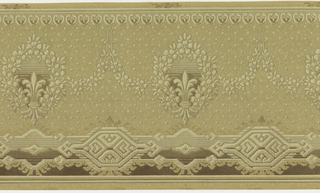 Frieze featuring floral wreaths terminating in fleur-de-lis bundles that repeat horizontally across the panel. Wreaths are connected with swagged floral garlands. Top of panel is bordered by row of small, inverse fleur-de-lis in heart shaped borders. Bottom of panel is bordered by large, geometric tribal design. A matrix of square dots fills the space between the top and bottom borders. Designs are rendered to resemble a woven textile, and are printed in shades of brown on a tan background.