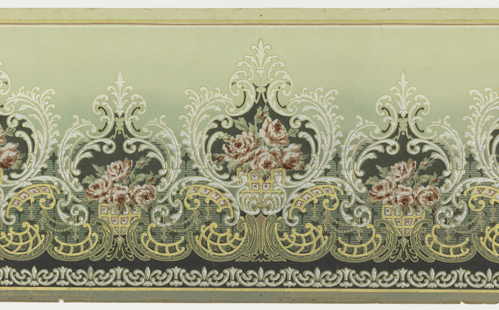 Bouquet of roses set within a scroll medallion, alternating with smaller medallion also containing bouquet. Band of fleur-de-lis motifs run along bottom edge. Printed in burgundy, white and gold on tan ground.