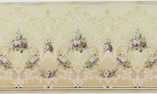 Flitter frieze with floral bouquets enclosed within medallions. White and gold foliate scrolls and trellis-work fill across bottom. Ground shades from light yellow at top to tan at bottom.
