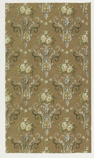 On light brown ground, scrolled motifs in white, light blue and dark green-black topped with cluster of white roses.
