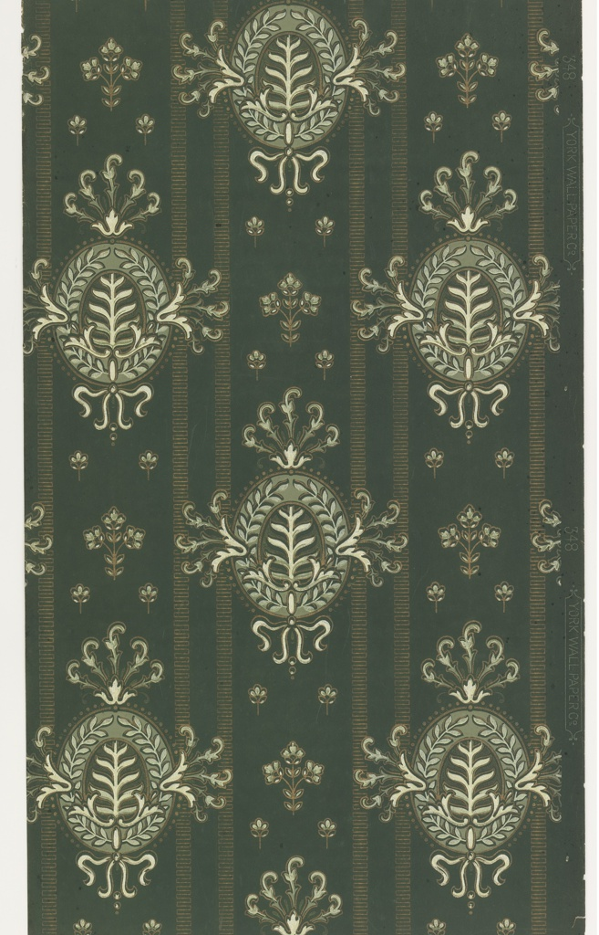 On dark gray-blue ground, vertical stripes with staggered white oval medallions composed of plants framed by ribbons and scrolls.