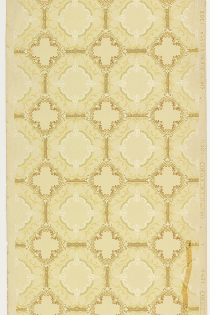 Tile design with quatrefoil motifs at intersection of octagons. Each octogaon has an inset circle. Printed in tan, green, yellow ocher, and white mica on light yellow or tan ground.