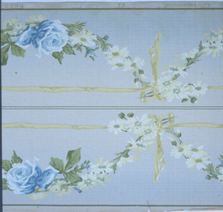 Floral swag, with a large blue rose at bottom of swag. Swag is suspended from a yellow ribbon with a bow knot .Printed on blue background that shades from light to dark. Printed two across.