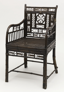 Armchair, square in plan, constructed entirely of bamboo except for caned seat. Back designed with small rectangular openings, each filled with tiny open motif. Similar worked details beneath armrest and along front rail. Varnished dark brown.
