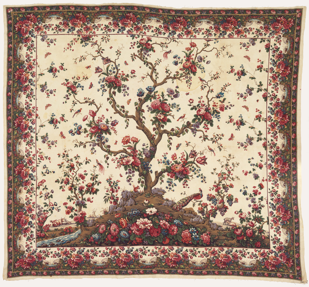 Mezzaro in a multicolored design on a white ground. Center shows a large-scale tree with many different blossoms. Small flanking tree on either side. Floral sprays, insects, birds and animals over the ground. Floral border with small inset landscapes with animals.
